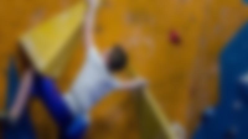 Boy bouldering at The Climbing Academy Boulder Club Glasgow