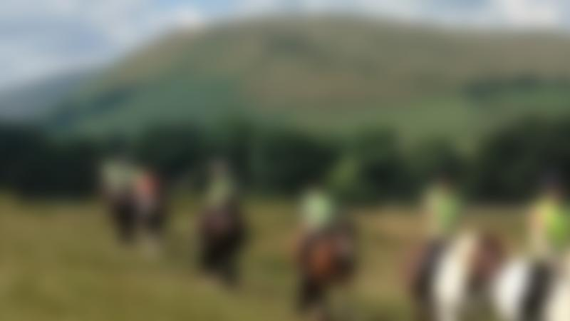 People riding horses at Stone Trail Riding Centre in Kirkby Stephen