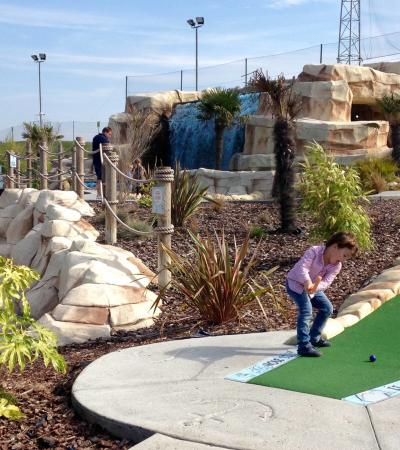 Kid playing mini golf at Golf Kingdom in Chadwell Heath