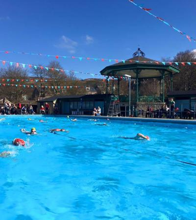 People swimming at Hathersage Open Air Heated Pool