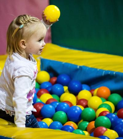 Girl in ball pit at Boomerang Play Centre in Melksham