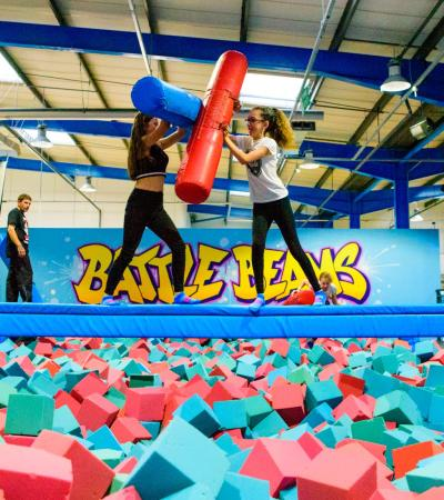 Girls playing above foam pit at Airhop Trampoline in Guildford