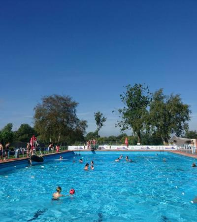 People swimming at Beccles Outdoor Swimming Pool in Beccles