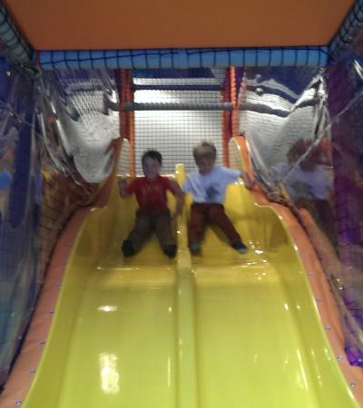 Kids on slides at Tick Tock Play in Aberdeen