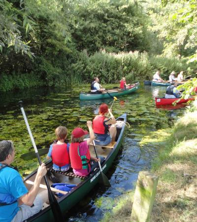 Families canoeing at Easton Farm Park in Woodbridge