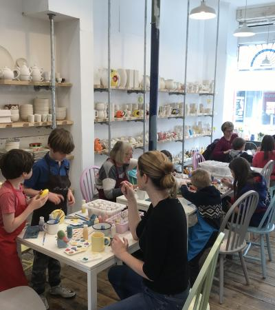 Families painting at Pitter Potter in Putney