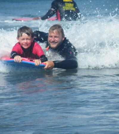 Instructor with boy at Atlantic Pursuits in Bude