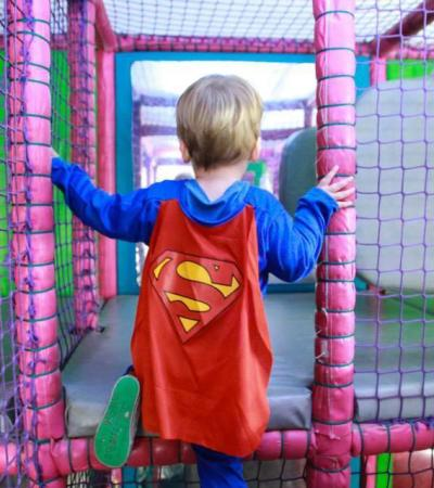 Boy in costume playing at Piglets - Indoor soft Play in Hersham