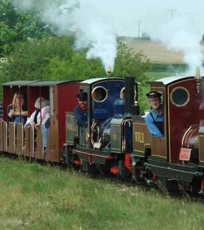 Families on miniature train at Wells and Walsingham Light Railway in Wells-next-the-Sea