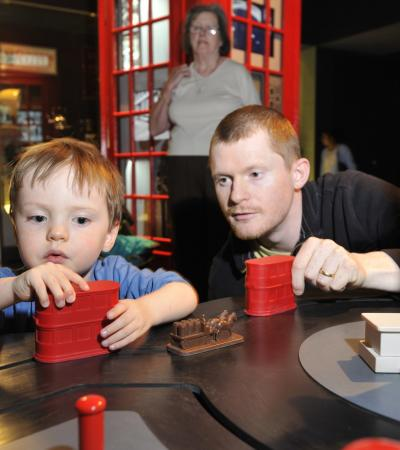 Dad and son playing at Museum of London in Barbican