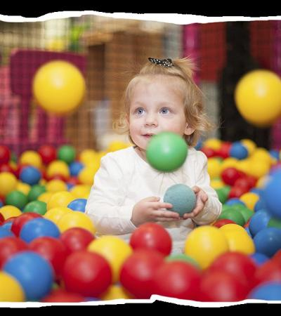 Girl in ball pit at Woodys Play Barn in Ware