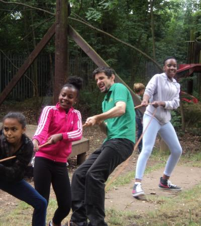 People playing tug of war at Goldhill Adventure Playground in Leicester
