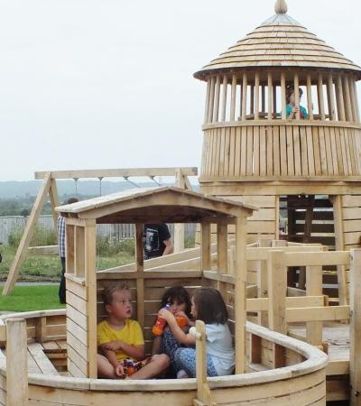 Kids on outdoor playground at Thurrock Thameside Nature Park in Stanford-le-Hope