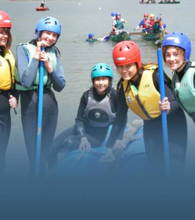 Girls in raft building activity at Ardingly Activity Centre