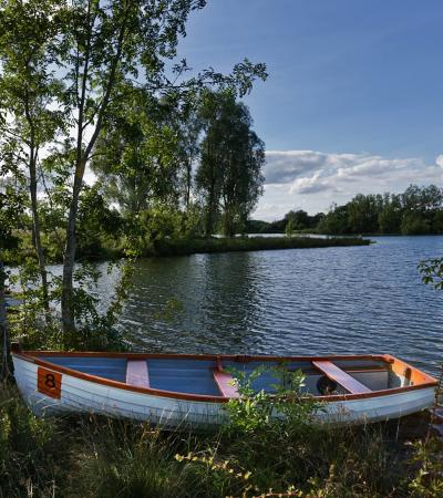 Boat in lake at Cotswold Water Park in Cirencester
