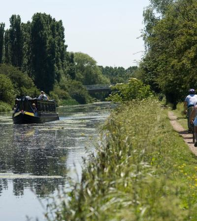Boat cruising on canal at Lee Valley Regional Park in Broxbourne