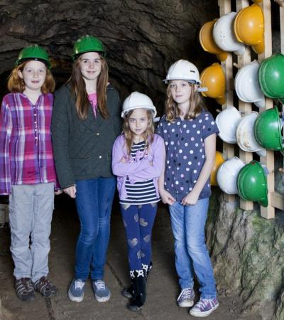 Girls in Temple Mine at Matlock Bath