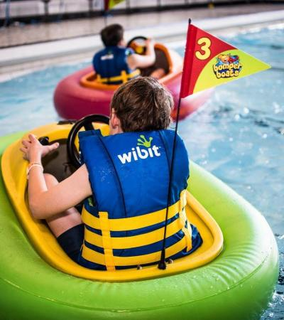 Boy in inflatable boat at Polar Adventure and Pool in Maidstone