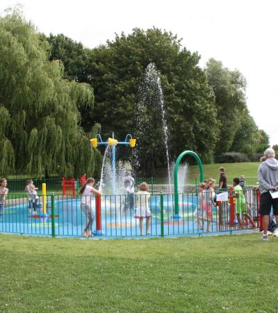 Kids on splash pad at Chaddesden Park in Derby