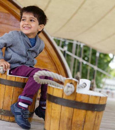 Boy in barrel at Cutty Sark Clipper Ship in Greenwich