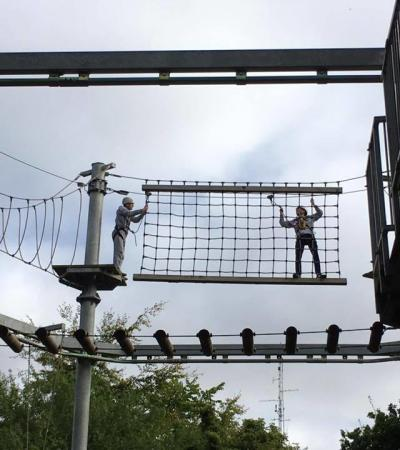 People on high rope course at SkyTrek in Belfast