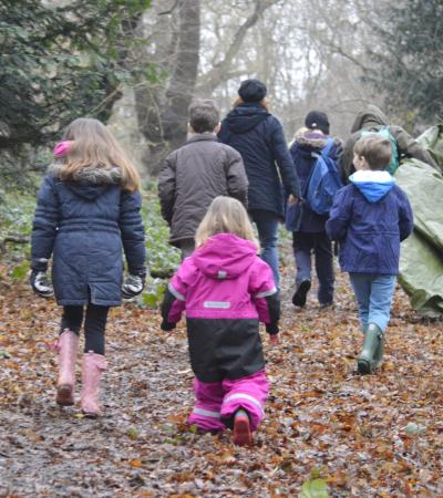 Family walking through Epping Forest and Visitor Centre
