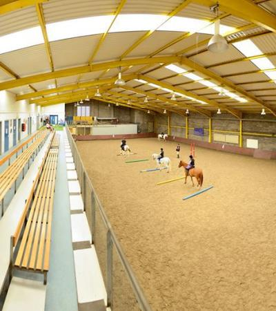 People learning horse riding at Stepney Bank Stables in Newcastle upon Tyne