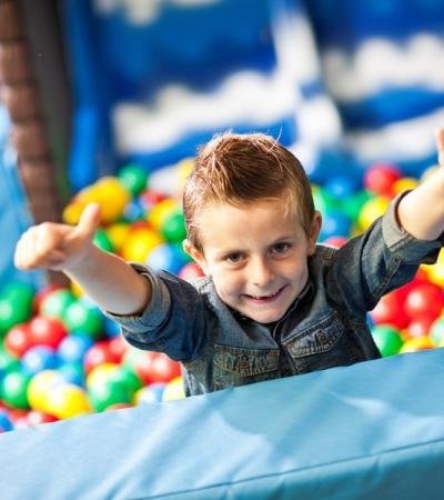 Boy in ball pit at Wacky Warehouse - Chequers in Dronfield