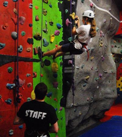 Girl on climbing wall at Revolution Climbing Centre in Broadstairs