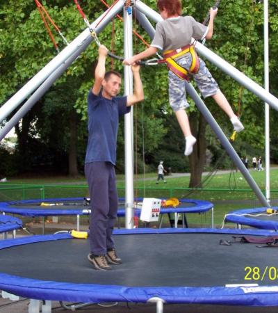 Dad and son on trampoline at Extreme Motion in Windsor