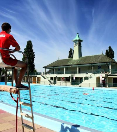 Lifeguard and swimmers at Peterborough Lido