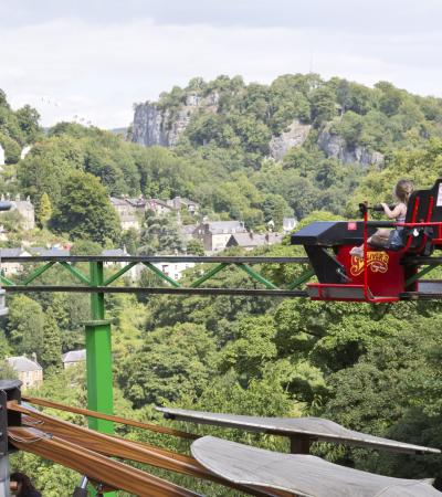 Visitors on Cycle Monorail ride at Gulliver's Kingdom in Matlock Bath