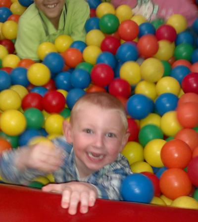 Boy in ball pit at The Play Barn Spalding