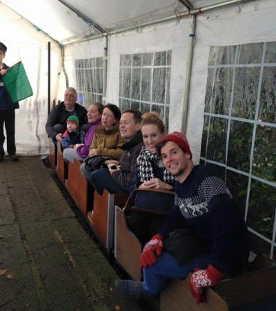 Family on miniature railway at Barton House Railway in Wroxham