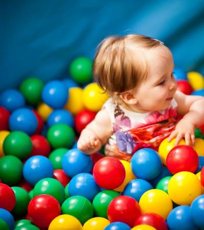 Girl in ball pit at Wacky Warehouse at the Fradley Arms in Linchfield