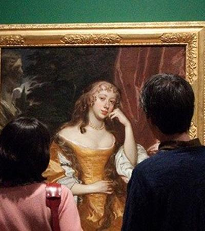 People looking at a portrait at Graves Gallery in Sheffield