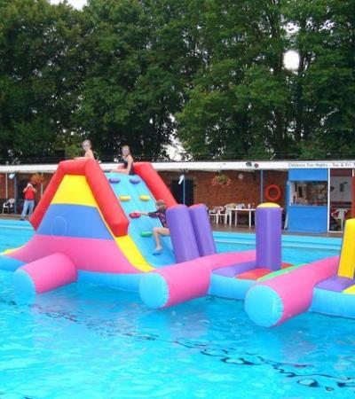 Inflatable course on pool at Bourne Outdoor Swimming Pool