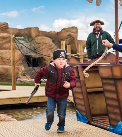 Boy dressed as pirate at Pirates Island Adventure Golf in Blofield