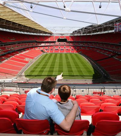 Dad and son sitting on stand at Wembley Stadium Tour