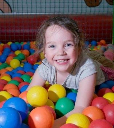 Girl in ball pit at Pick N Mix Playstore and Go Bananas in Woking