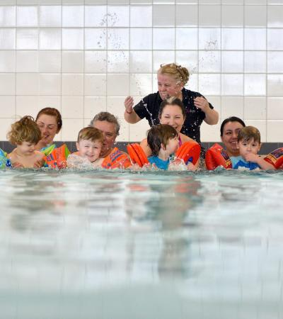 Toddlers in swimming lesson in pool at Northgate Arena in Chester