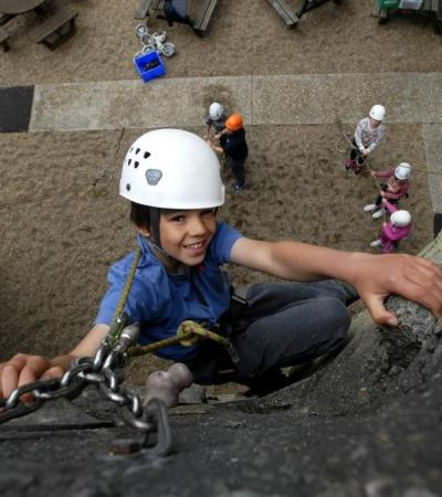 Boy rock climbing at Arethusa Climbing Centre in Rochester