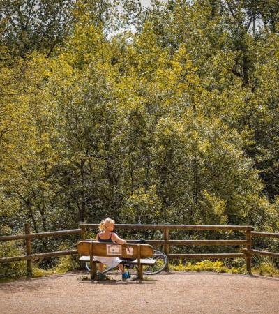Woman on bench at Irchester Country Park in Wellingborough