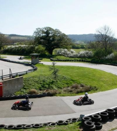 Kids racing on go karts at Q Leisure in Albourne