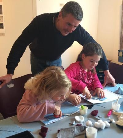 Family doing arts and crafts at Surrey Heath Museum in Camberley