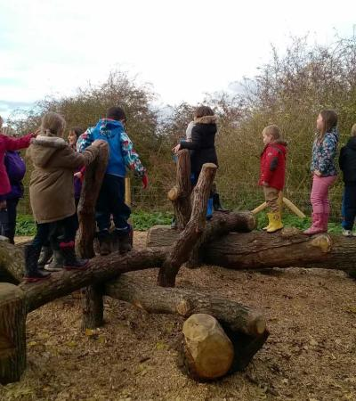 Kids on wooden obstacle course at Fermyn Woods Country Park in Brigstock