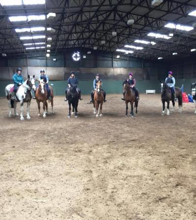 People on horse back at Woodland Park Equestrian Centre in South Walsham