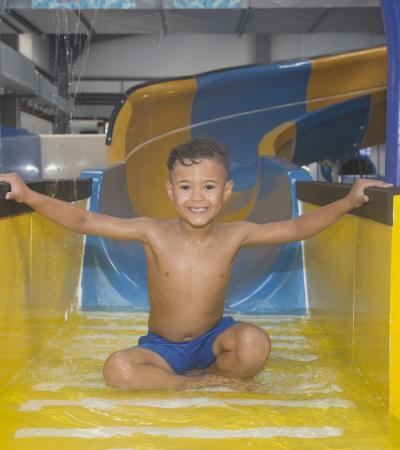 Boy on slide at Gulliver's Splash Zone Milton Keynes