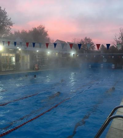 People swimming at Chesham Heated Open Air Pool