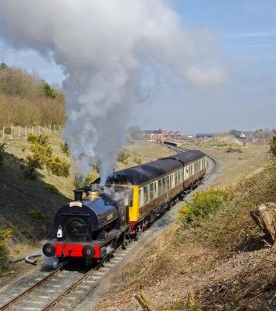 Train traveling at Telford Steam Railway